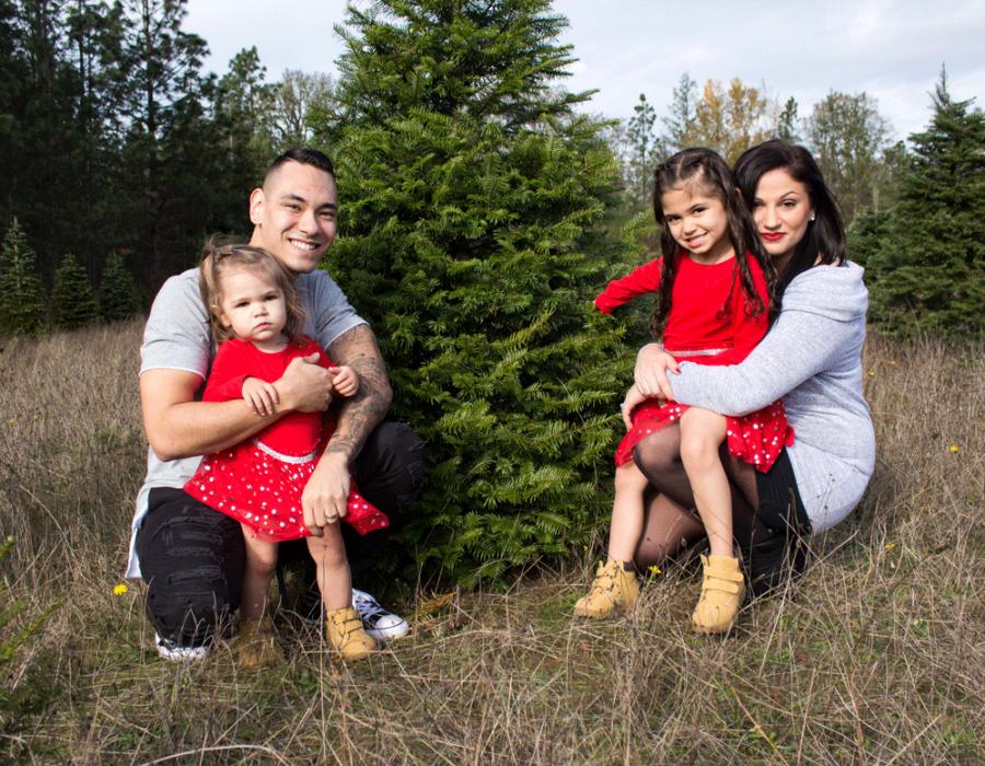 bailey-family-christmas-card-photos-group-photo-sitting-around-a-christmas-tree