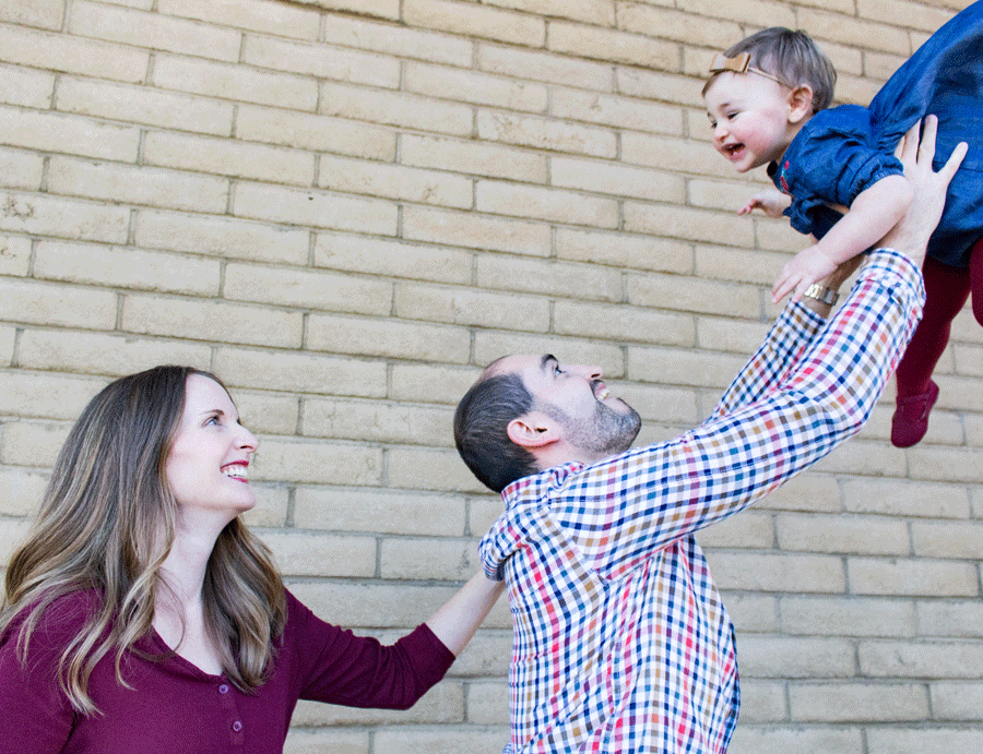 family-photography-daddy-tossing-toddler-in-air-outside