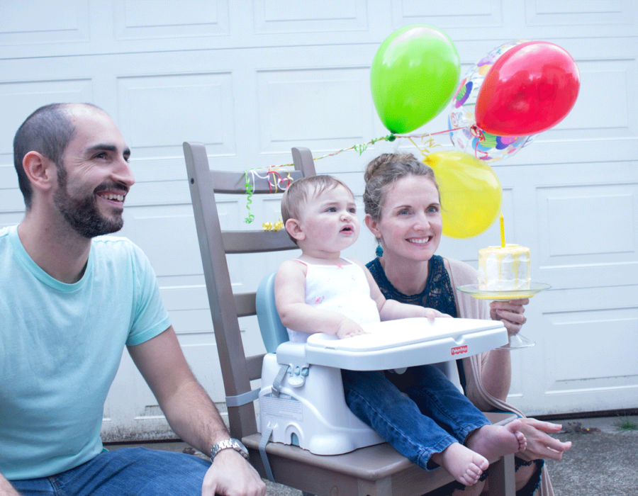 first-birthday-parents-serving-baby-yellow-and-white-cake-photo