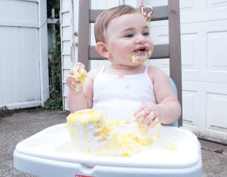 louisa-with-cake-all-over-her-face-highchair